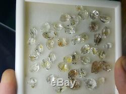 Petrolium diamond quartz Crystals 42 pieces with Yellow visible petrol inside
